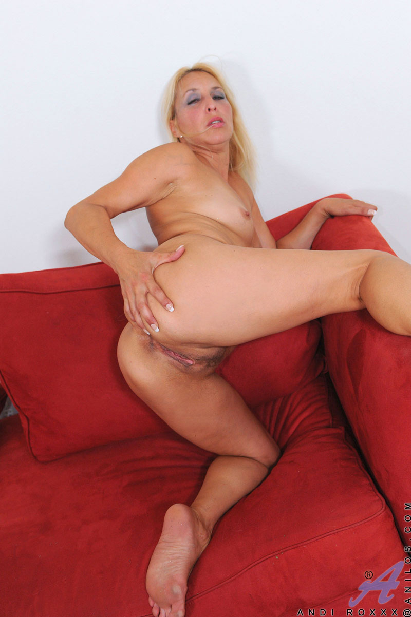 Blonde cougar Andi Roxxx teases her milf pussy with her fingers