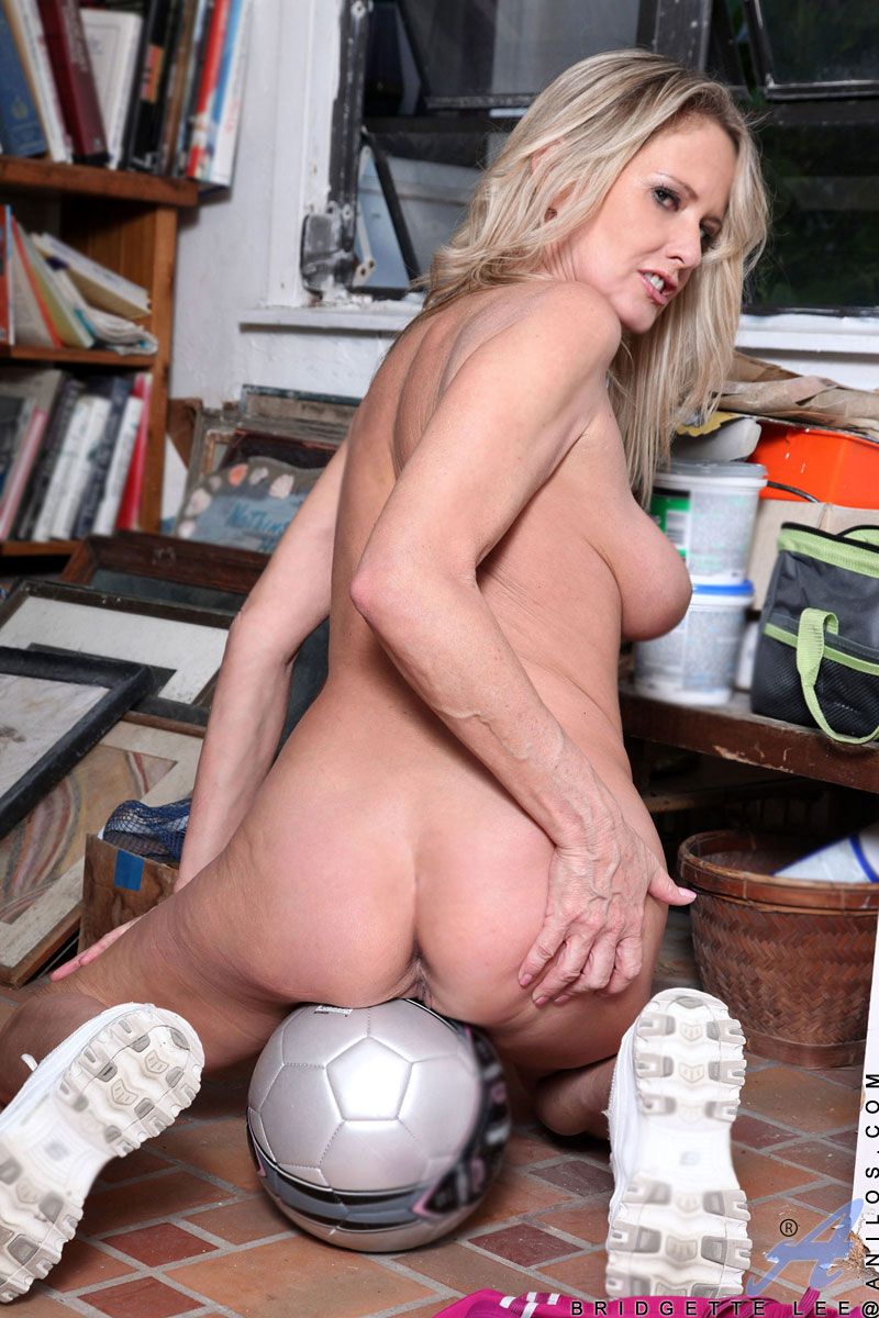 image Blonde soccer mom shows her big tits and wanton pussy