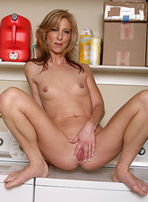 Attractive mature cougar shows off her elongated nipples in the laundry room from Anilos.com