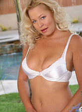 Curly haired blonde anilos shows off her captivating frame in the park from Anilos.com