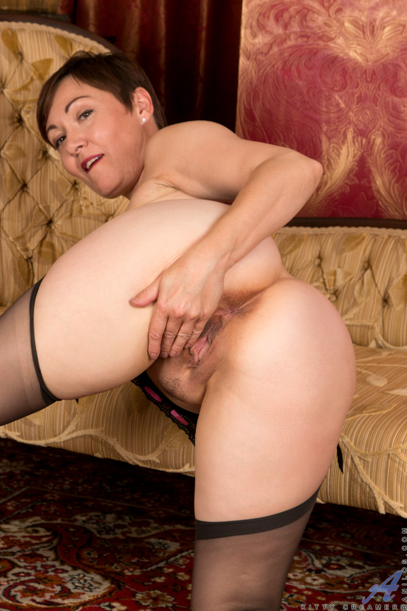 image English milf kitty cream puts her fingers to work
