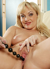 Cock starved cougar takes turns fucking her needy pussy and asshole with anal beads from Anilos.com