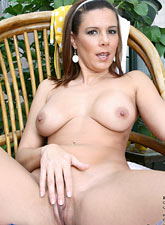 Brunette Anilos Victoria loves to expose her experienced shaved pussy while she hangs out in her garden from Anilos.com