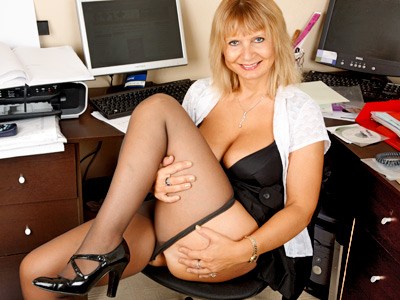 Horny executive takes a break to gaiety with her huge tits and pussy
