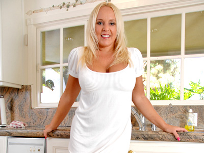 Tan blonde woman of the house with big tits mastubates in the kitchen sink