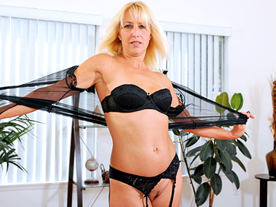 Pretty blonde housewife masturbates wonderful wearing stockings