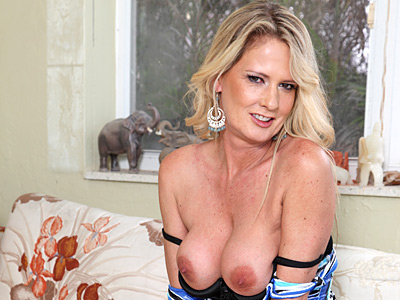 pretty blonde soccer mom masturbates with a toy doggystyle