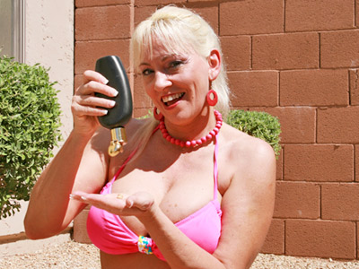Hot blonde milf rubs tanning oil on her soft skin from Anilos.com