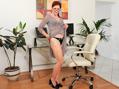 Hot secretary slips by her dress and fucks a glass toy in the office