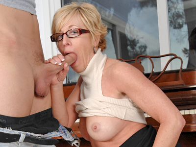 Sexy milf in glasses sucks and bonks her boy toy