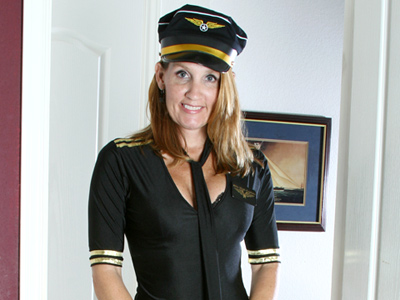 Enticing cougar takes off her pilot costume washstand shows her pussy