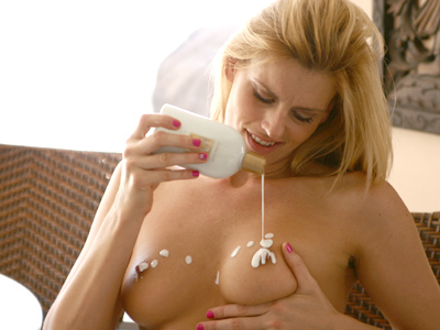 Darryl Hanah plays seclude sexy lotion on her sweet naturally large boobs