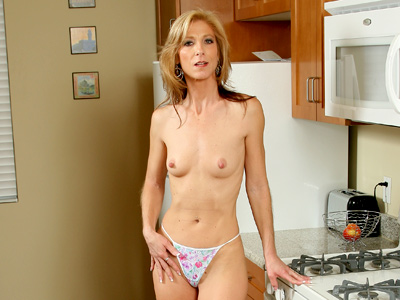 After giving her dildo a tongue bath Dee Dee removes her clothes from Anilos.com