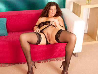 Gilly stuffs her thick cougar pussy with the rabbit toy from Anilos.com