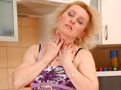 Blonde milf Jane plays with her mature pussy on the kitchen counter