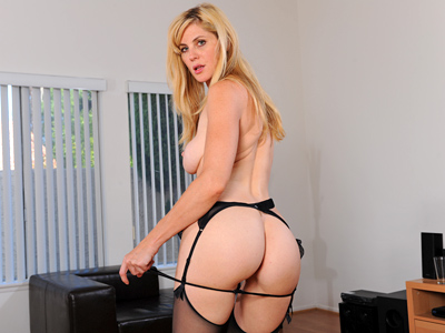 Leggy blond Anilos vixen plays with her pussy wearing sheer stockings