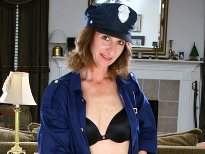 Naughty Anilos milf slips off her cop uniform and masturbates