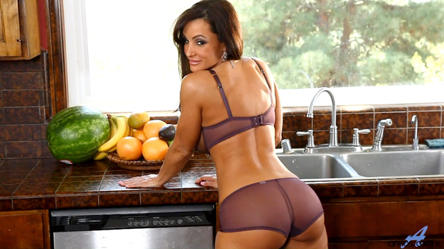 Busty Anilos housewife masturbates on her kitchen counter