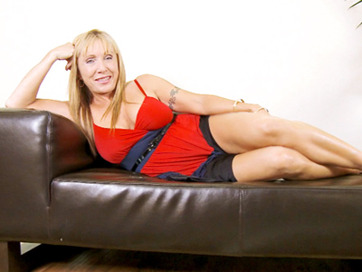 bristly cougar Luna masturbates with a red vibrator