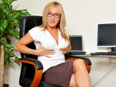 Horny big breasted secretary masturbates in thereon office