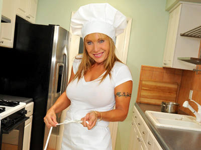 Blonde housewife masturbates with the rabbit after cooking dinner