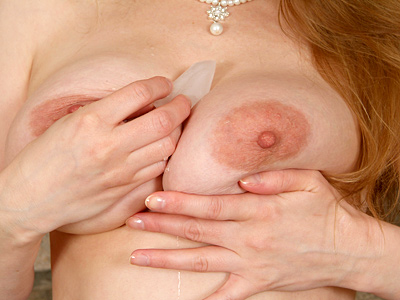 Red headed cougar fox teases her nipples with an ice cube from Anilos.com