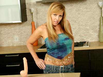 Nicole Moore eagerly shows off her superb clitoric talents on an innocent dildo