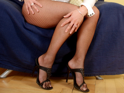 Uninhibited milf nicoletta peels off her charming black fishnets and gives her toes some oral attention