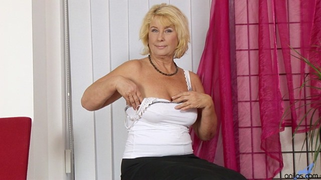 Anilos Regie bends over in her high heels and fingers her pussy