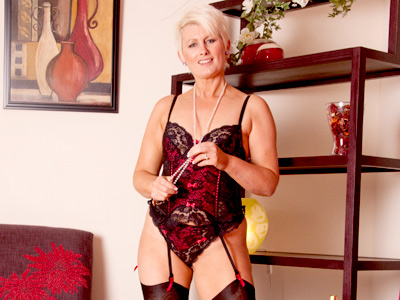 lady of the house in sexy lingerie stuffs her pearl necklace in her snatch