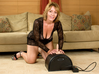 nice looking cougar thoroughly enjoys her first sybian ride