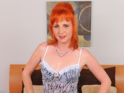 Brilliant red haired milf tortures her hairy pussy with a dildo