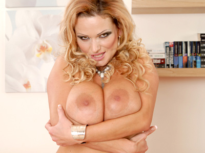 Sharon Pink is an Anilos stunner with wavy long blonde hair and an enormous