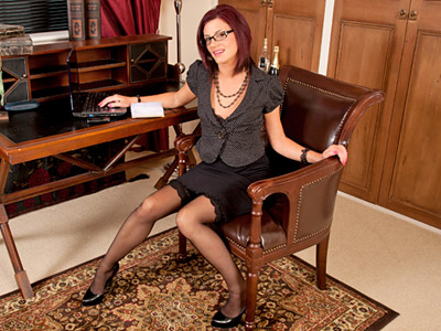 Hot secretary wearying glasses plays with her fuzzy pussy