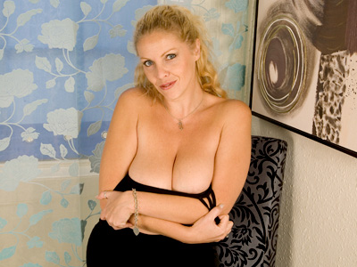 Busty light haired chick Anilos Teya masturbates on the floor