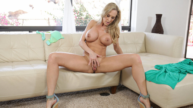 Stunning cougar Brandi Love shows off her enormous melons and built body in a miniature thong and then uses both hands to bring her craving cunt to body shaking orgasmvideo