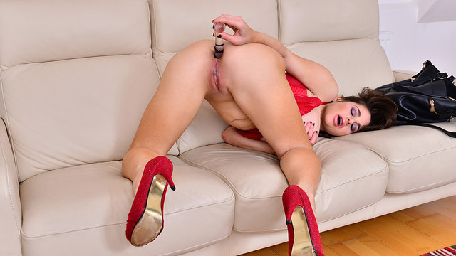 Horny milf toy fucks her ass until she