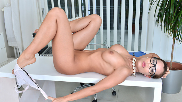Sexy milf masturbates on her office desk