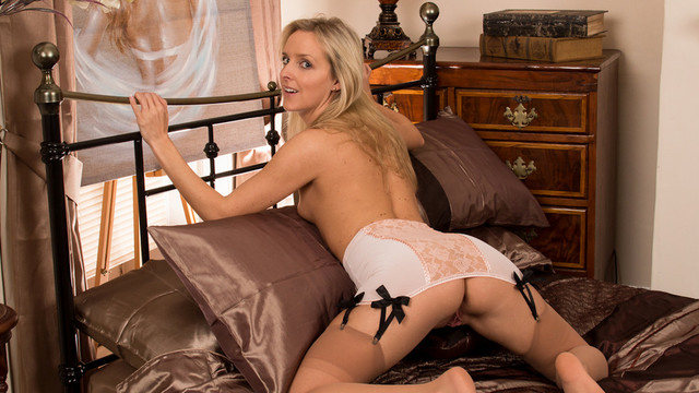 Sexy blonde housewife is a little nervous about her first adult shoot but quickly warms up as she strips down to her stockings and massages her craving cookievideo