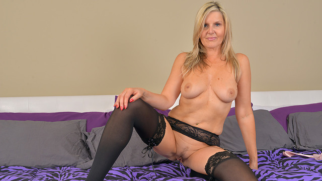Horny blonde mommy Velvet Skye strips out of her lingerie and caresses her nice body. Once she is all worked up she begins massaging and finger fucking her pink wet pussy until she reaches orgasmic pleasure. video