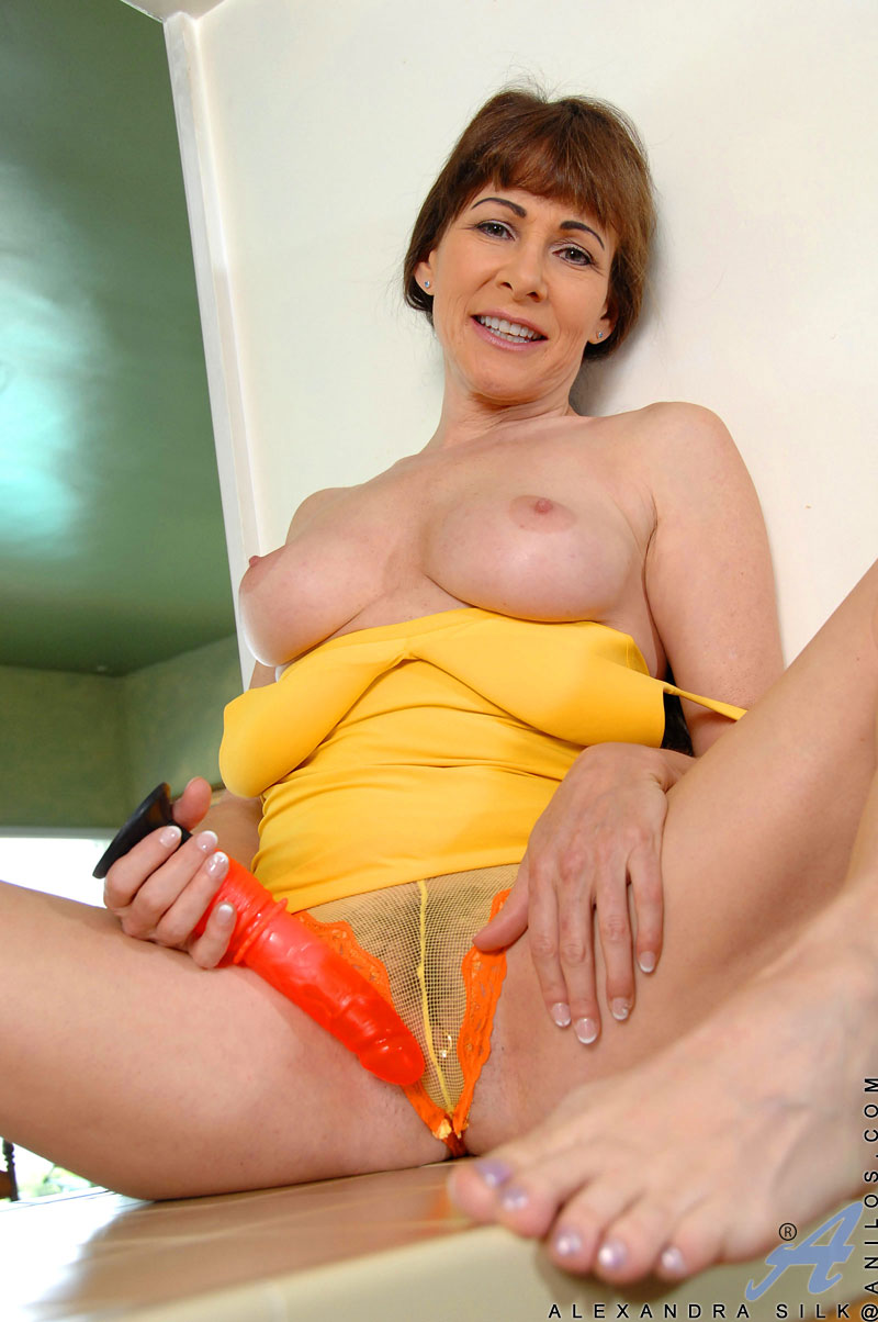 Busty brunette soccer mom fucks herself on the kitchen counter