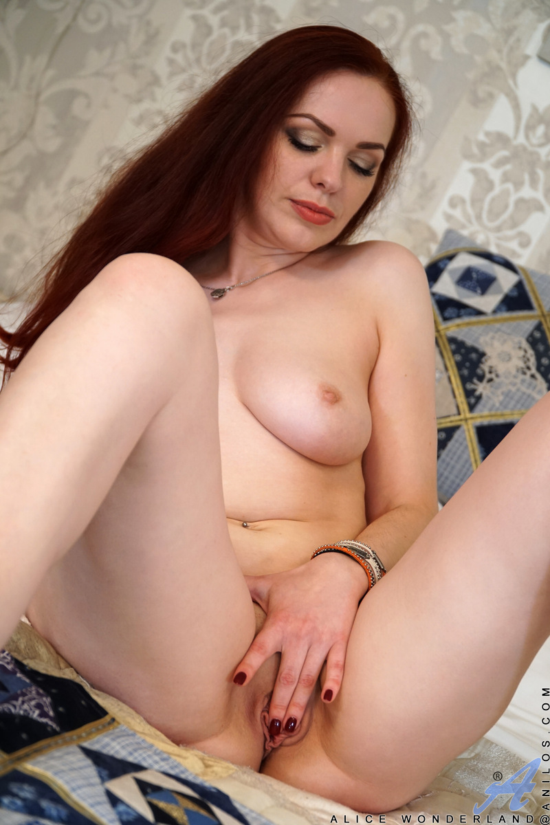 Alice Wonderland is one hell of a milf that you'll want to start fucking and never stop! She looks amazing in lingerie, but as she slowly shimmies out of the gown her full all naturals tipped with pink nipples and her smooth landing strip cunt will grab y