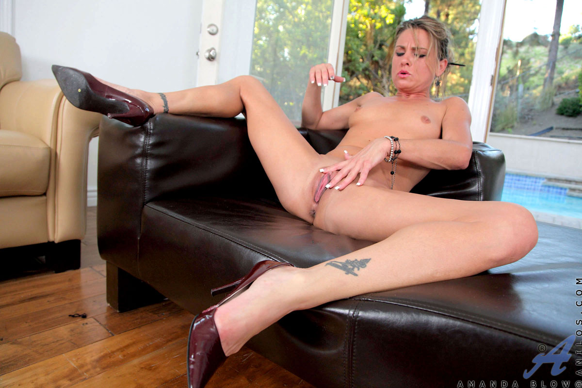 Petite blonde cougar fingers her hot pussy at Anilos