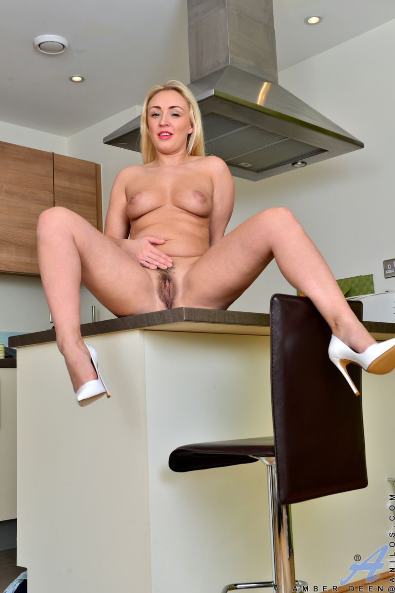 Get redressed in an evening gown that leaves nothing to the imagination, Amber Deen shakes her big hanging tits and firm ass. When she peels off her miniskirt dress and pulls her thong aside, you'll get to enjoy a hairy fuck hole that creams with sweet ju