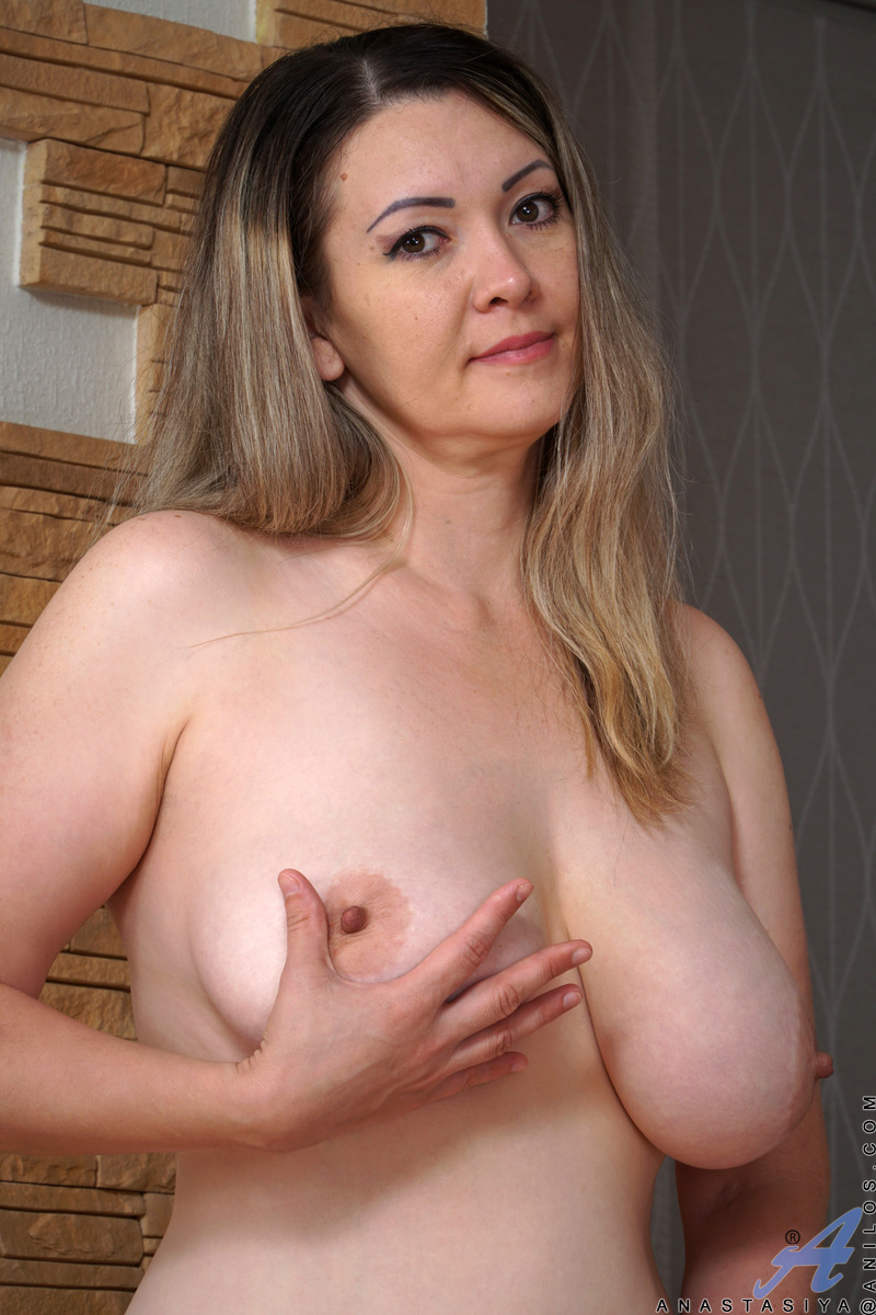 Bigtit milf Anastasiya is a buxom delight whose giant knockers are all natural. This horny housewife is happy to show off her assets. Once she gets started, she won't stop playing with her bare fuck hole and huge boobs until she has used a big dildo to ma