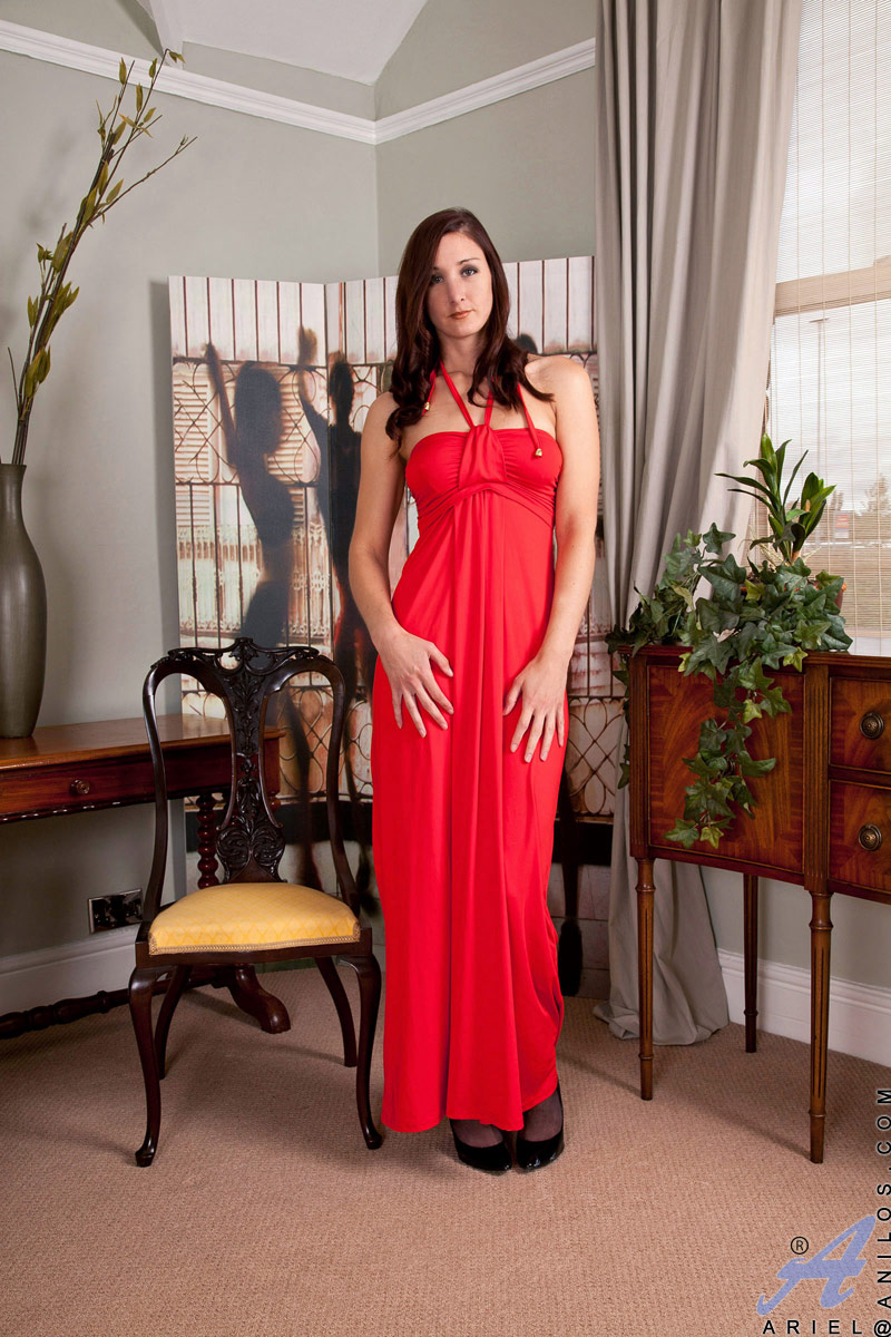 Slender and sensual milf Ariel strips off her gown to get comfortable but cant resist massaging her moist pink pussy