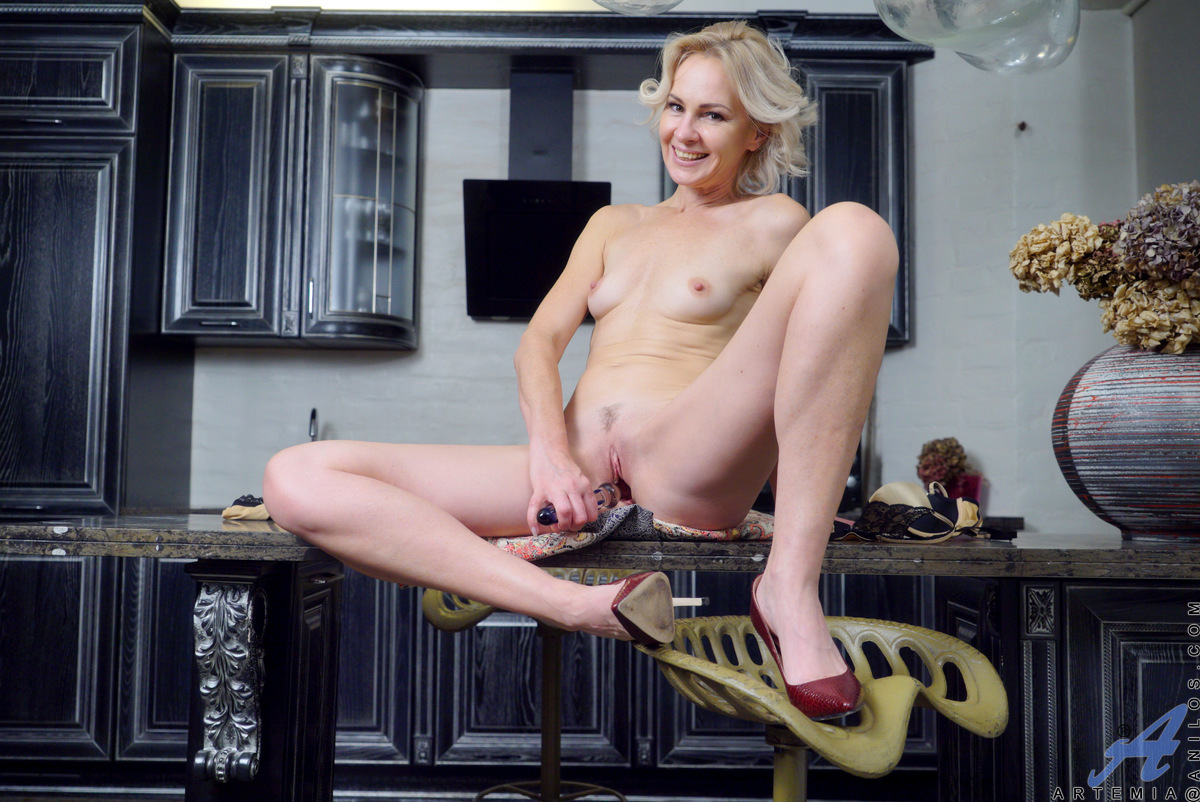 Perky blonde Artemia is a Russian babe with attitude! Watch this horny mom show off her newest dildo. Pulling up her miniskirt and peeling off her panties, she puts her toy to work with a titty fuck and a hard pussy pounding in her landing strip cunt unti