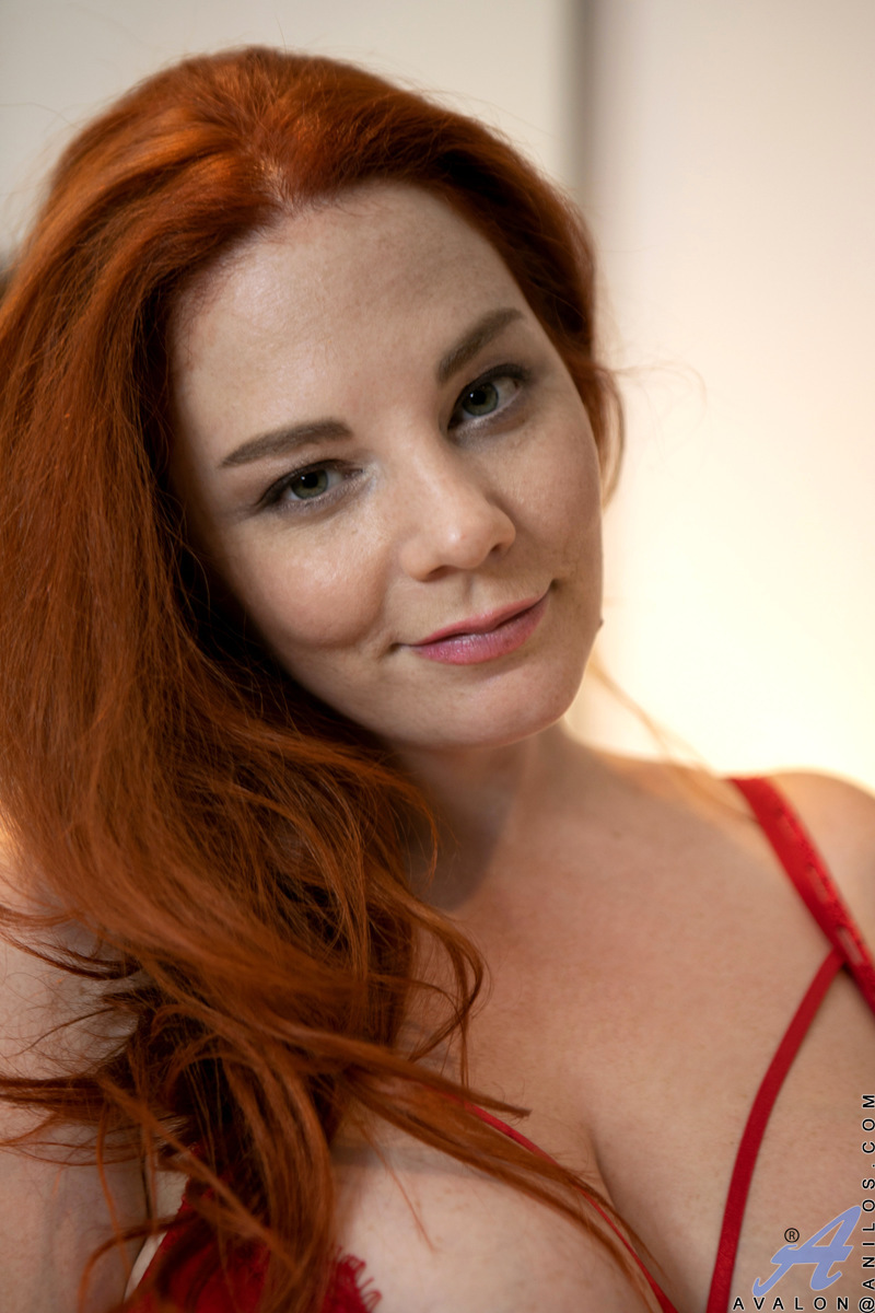Big breasted mom Avalon is a delightful redhead with a fuck me attitude. She'll entice you to cum inside as she shows herself off in red lingerie. After caressing her big boobs and meaty bare twat, she grabs a dildo to push deep inside her tight snatch in