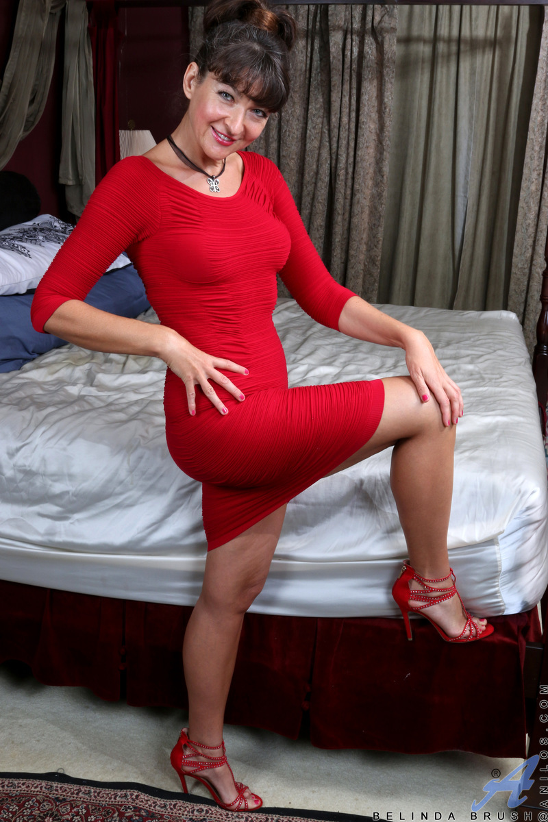 Wouldn't you love to have a date with scrumptious mom Belinda Brush? This American bombshell still has it going on at 48! Peel her out of her evening gown and sassy thong that teases her clit, and enjoy her tan lined tall figure and her always wet and rea