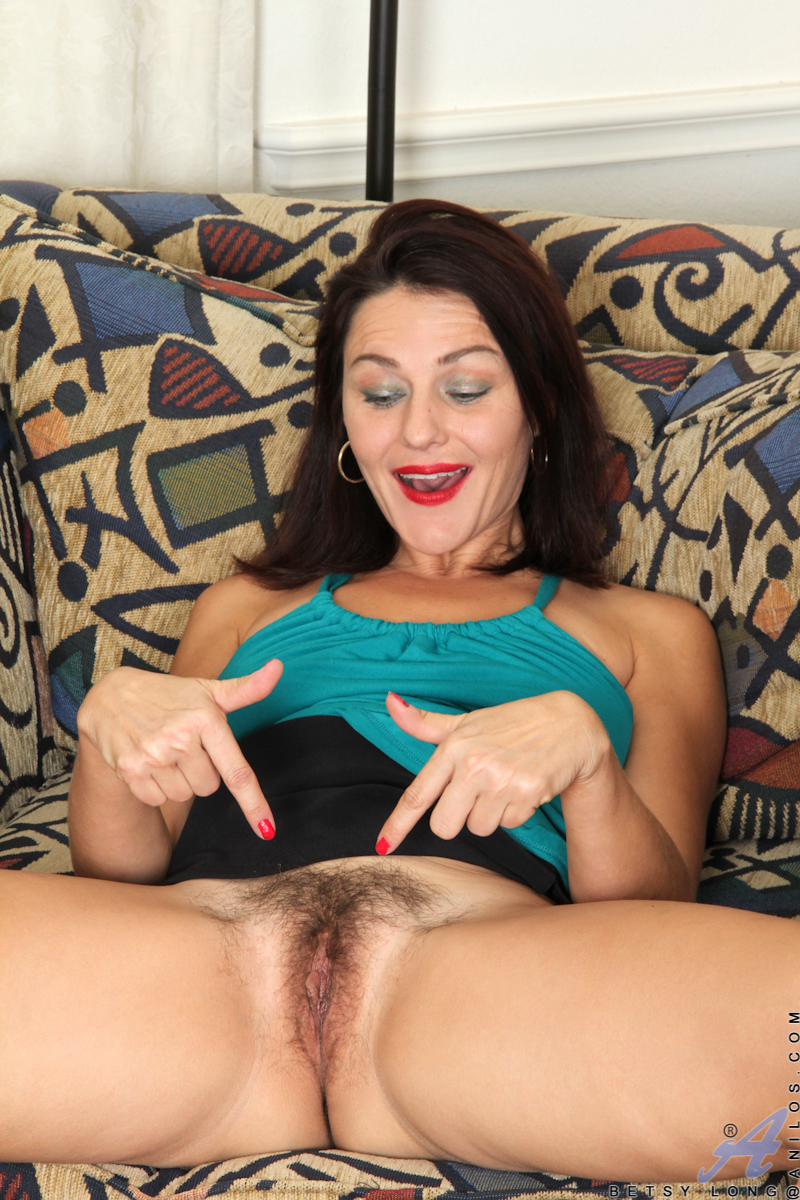 Super sexy Betsy Long is a hot American mom who loves to show off her incredible finger with tight shirts and short skirts that reveal peaks of her hairy pussy and panties. Realizing she's too horny to wait, this cum craving milf throws off her clothes an